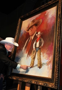 Artist Harley Brown shows the final brush stroke he added at the last minute before delivering the artwork that will be