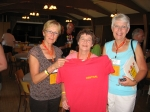 Nora Bowler (Christensen), Bev Pomrenke (Bregg) and Faye Little (Rudland) hold up donated CCI shirt