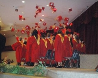 Central Collegiate Institute graduates toss their caps at the end of Wednesday's graduation ceremony at Hillcrest A