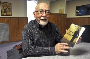 Local author and poet Robert Currie shows off his newest book, Living with the Hawk.